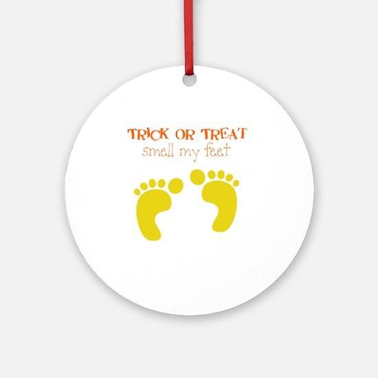 ttick or treat feet Round Ornament