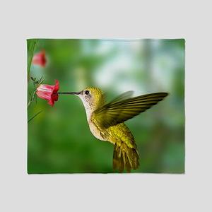 Hummingbird in flight Throw Blanket