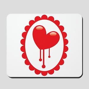 Bleeding red heart Mousepad