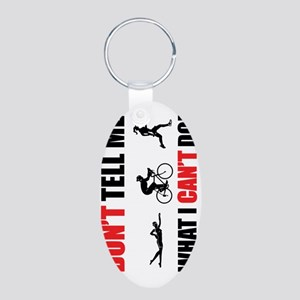 2-Copy of Dont-Tell-me-what Aluminum Oval Keychain