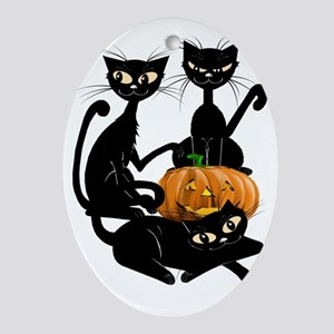 Three Black Kitties and a PumpkinTra Oval Ornament