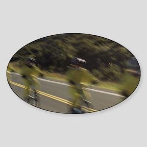 Bikers speed down Haleakala volcano Sticker (Oval)