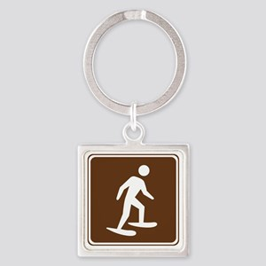 brown_snowshoeing_sign_real Square Keychain