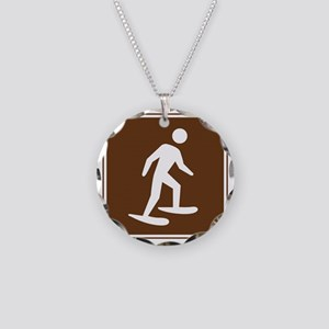 brown_snowshoeing_sign_real Necklace Circle Charm