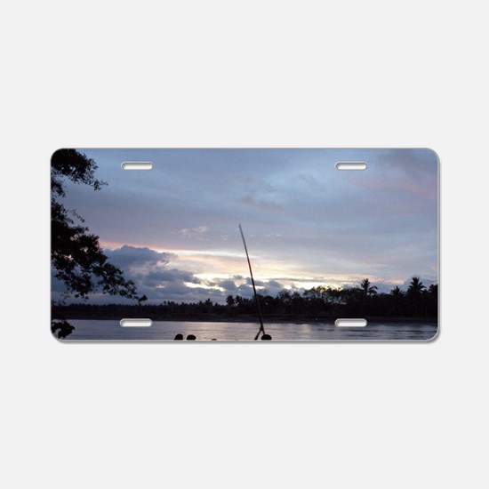 Works poling a bamboo raft  Aluminum License Plate