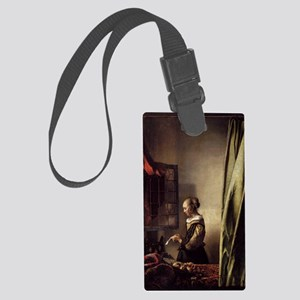Girl Reading a Letter at an Open Large Luggage Tag