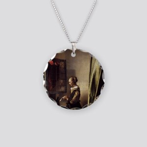 Girl Reading a Letter at an  Necklace Circle Charm