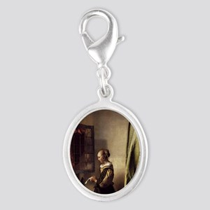 Girl Reading a Letter at an Ope Silver Oval Charm