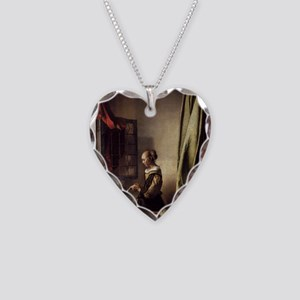 Girl Reading a Letter at an O Necklace Heart Charm