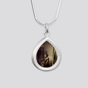 Girl Reading a Letter at Silver Teardrop Necklace