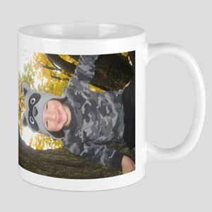 Carter in tree with hat Mugs