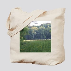 Field and Meadow surrounded by Forest Tote Bag