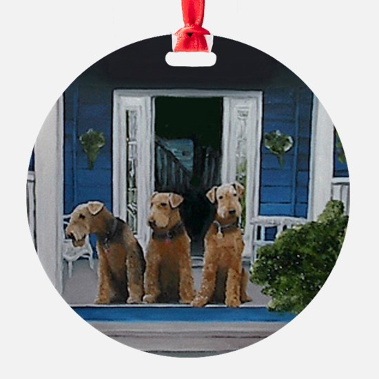 3 Airedale on porchll Ornament