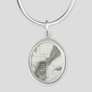 De L'Ile Gwam (Guam) Freycine Silver Oval Necklace
