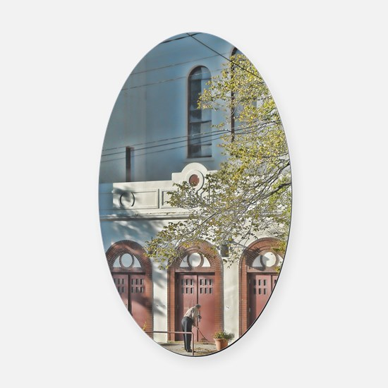 man_sweeping Oval Car Magnet