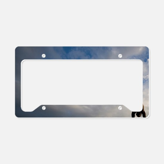 Silhouette of young man leapi License Plate Holder
