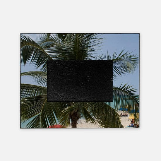 Tourists and palm tree along white s Picture Frame