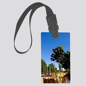 Woman collecting sugar canes sta Large Luggage Tag