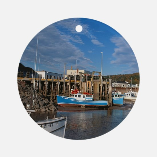 Fishing boats docked at low at in t Round Ornament