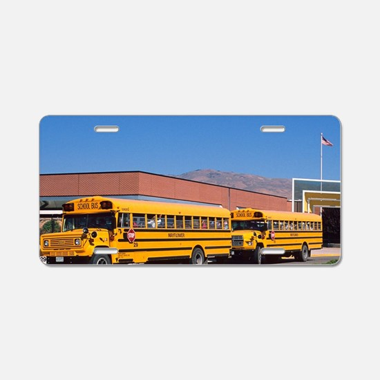 School buses parked in fron Aluminum License Plate