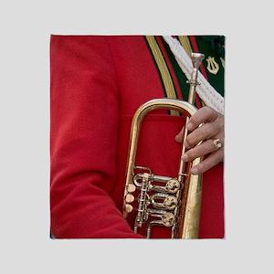 Brass band member in traditional Tir Throw Blanket