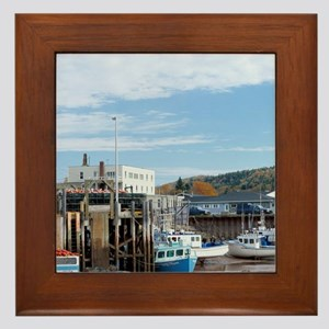 Lobster boats tied up to dock at low t Framed Tile