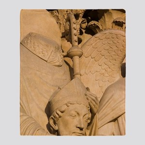 Sculpture on facade of Notre Dame Ca Throw Blanket