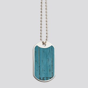 Valensole. Mail slot in blue painted door Dog Tags