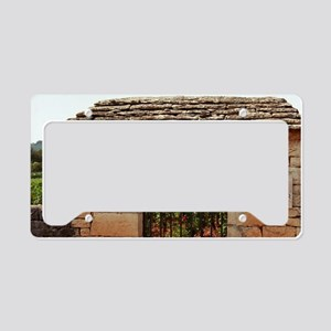 Taboureau. An iron gate and s License Plate Holder