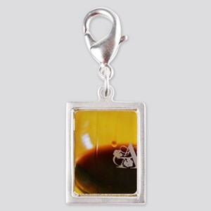 Glass embossed with A. Domai Silver Portrait Charm