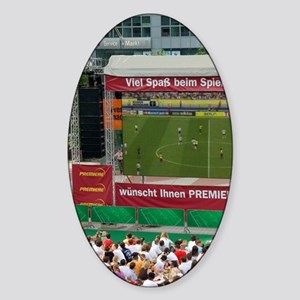 A crowd outdoors at the Munich airp Sticker (Oval)