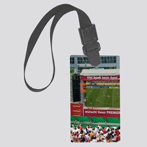 A crowd outdoors at the Munich a Large Luggage Tag
