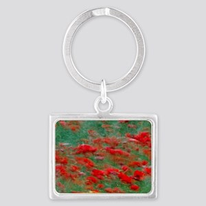 Red poppies bloom in a green fi Landscape Keychain