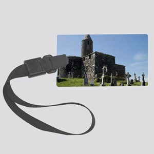 Beside ruins of stone church and Large Luggage Tag