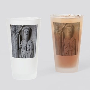 Medieval stone carving of a Saint a Drinking Glass