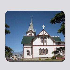 Iceland's cross-shaped church over looki Mousepad