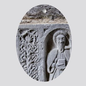 Medieval stone carving of a Saint at Oval Ornament