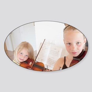 Young sisters show their violin ski Sticker (Oval)