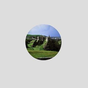 Dunluce Castle. Dunluce Castle rises f Mini Button
