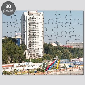 Pebble beach and amusement park on Black Se Puzzle