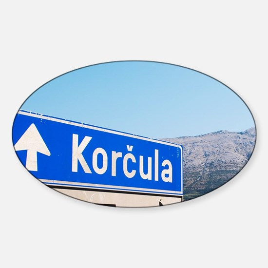 Road sign saying Korcula, view acro Sticker (Oval)