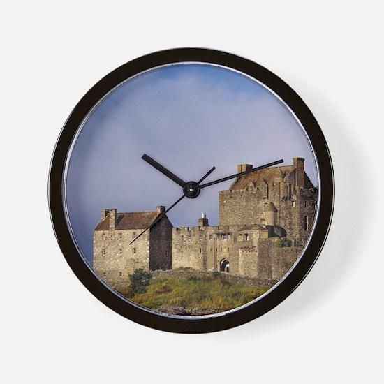 Eilean Donan Castle. Afternoon light fl Wall Clock
