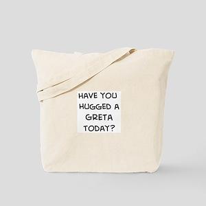 Hugged a Greta Tote Bag