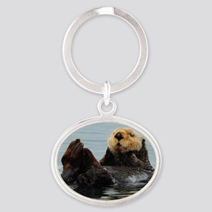 115x9_calender_otter_10 Oval Keychain