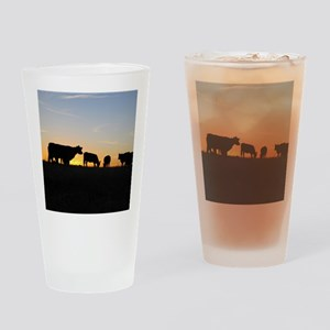 Cows at sundown Drinking Glass