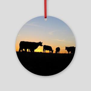 Cows at sundown Round Ornament