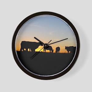 Cows at sundown Wall Clock