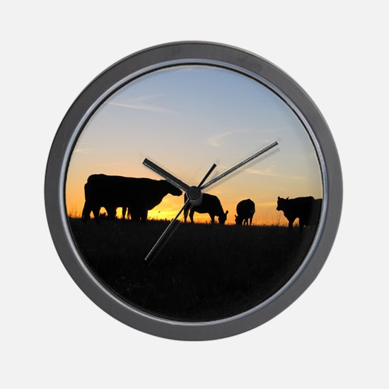 Cows at sundown Wall Clock