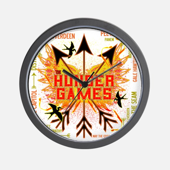 hunger games gear with 3 black arrows a Wall Clock