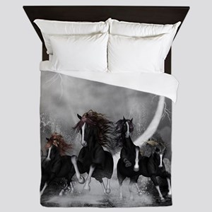 Awesome wild black horses running in the night Que